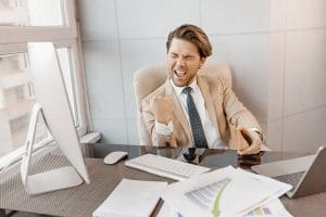 Overjoyed male employee in stylish formal suit