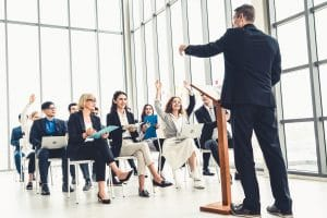 Group Of Business People Meeting In A Seminar Conference