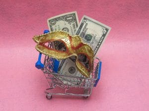 Toy shopping cart on a pink background